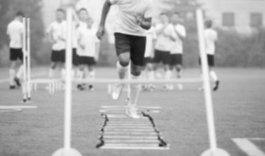 person running hurdles