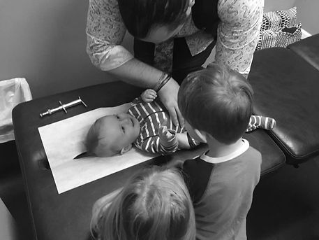 Chiropractor working with a toddler