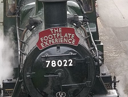 Smiley steam train driver or Ghost train?