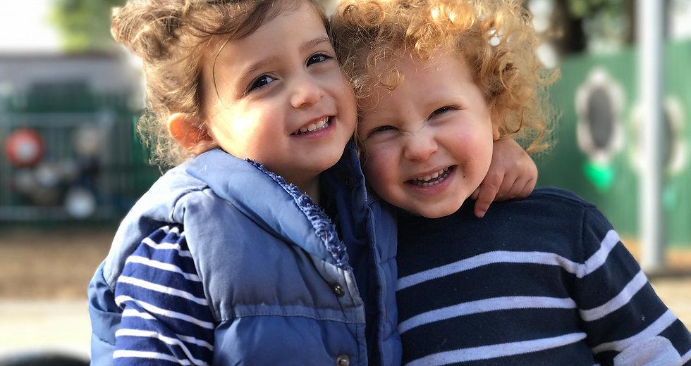 Two children smiling.jpg