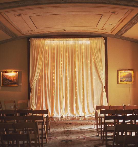 Monique ceremony drape empty room.jpg