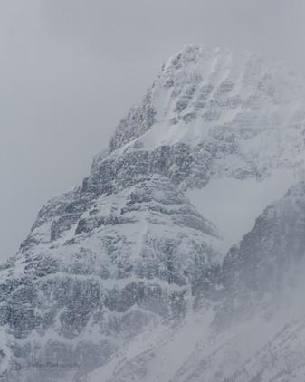 Snowy Peaks in the Clouds