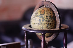shallow-focus-photography-of-brown-globe