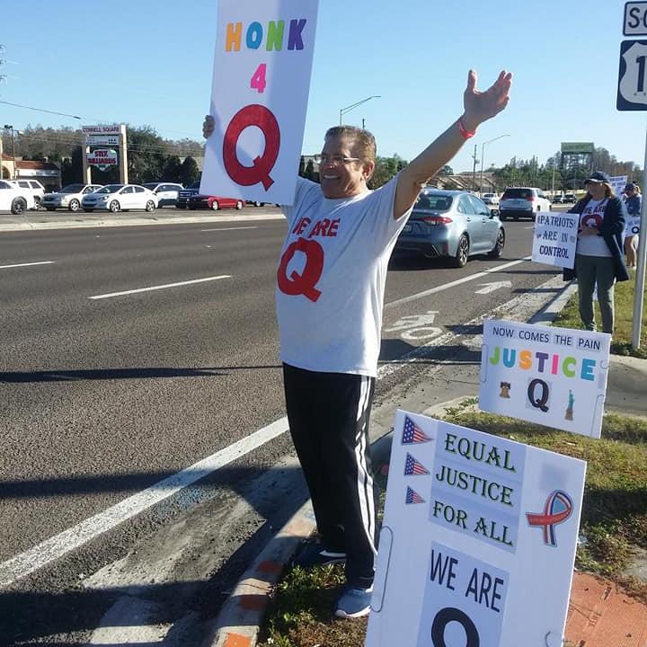 Peaceful Q Patriots sign wave