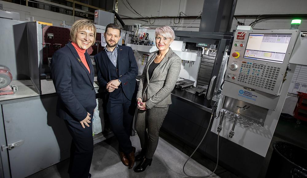 County Durham Growth Fund staff in front of machine
