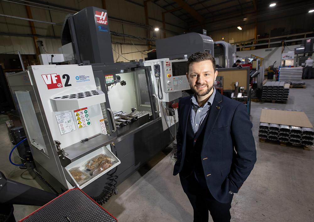 Mark Coatsworth in front of machine