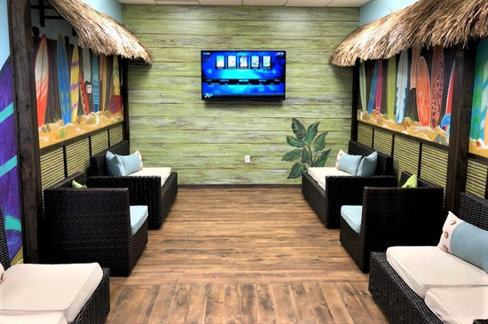 Faux wood wall with surfboard murals