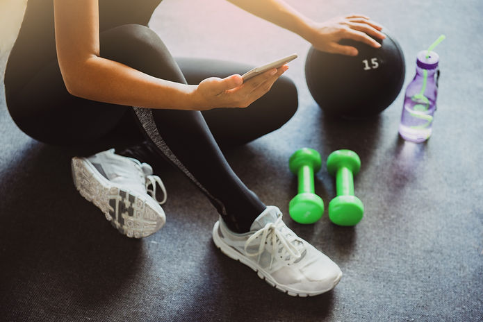 Woman using smartphone during workout at