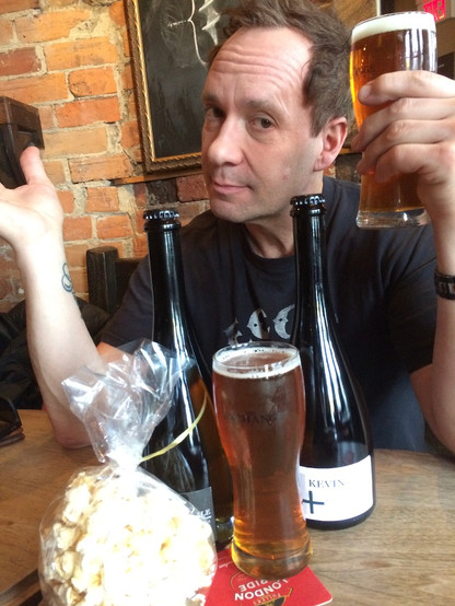 TV personality and beverage expert, Kevin Brauch, with his custom Exchange Brewery pack