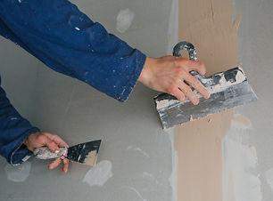 plasterer-man-works-plastering-two-trowe
