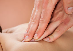 Dr Ryan Coster Moncton Chiropractor uses muscle therapy and massage to treat back pain.