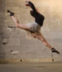 Beautiful, elegant, feminine Trienawear ballerina ambassador, Natalie Jessie, grande jete, and why she loves ballet