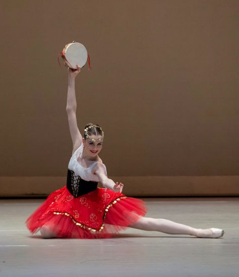Beautiful, elegant, feminine Trienawear ballerina Breana Drummond performing a classical ballet variation at competition