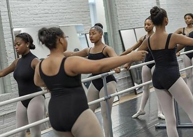Beautiful, feminine, elegant Trienawear ballerina ambassador Sage Sarai at the barre in ballet class