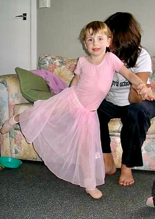 A young Breana Drummond becoming a ballerina with her first ballet arabasque