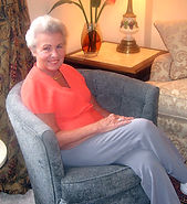 Pheobe, a client of Interiors for Seniors, comfortable and content after her move