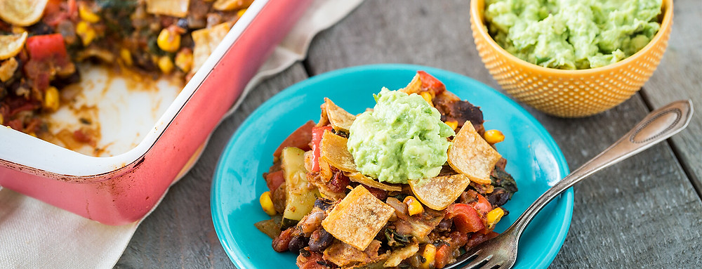 Mexican based vegan casserole with chips and avocado