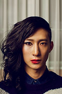 Genderqueer or nonbinary Asian person from shoulders up, 1 side long hair, 1 side short, lipstick
