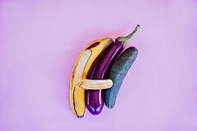a banana spooning an eggplant spooning a cucumber