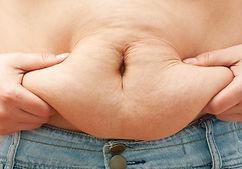 bigstock-Fat-woman-body-measuring-stom-6