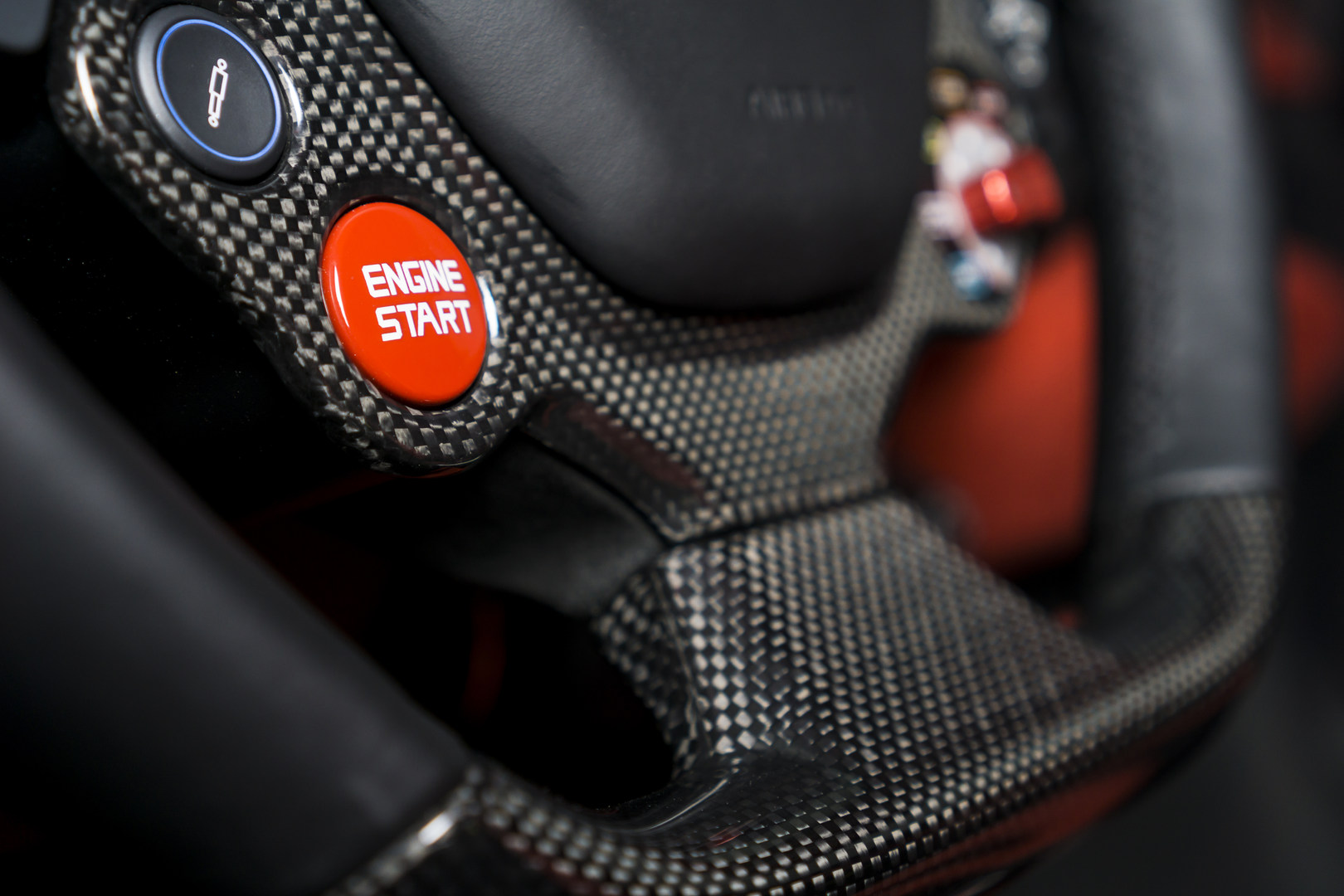 Close up carbon fibre steering wheel wit
