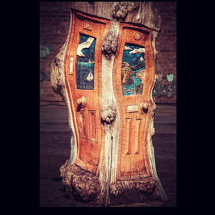 Wooden door sculpture carved into a tree at Henshaws arts and crafts centre