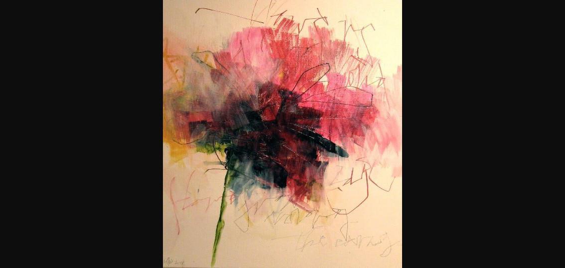 Flowers grow among the carnage