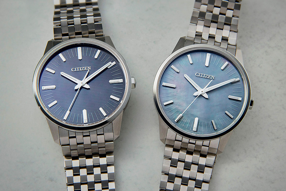 AQ6020-53X reloj de cuarzo con esfera de nacar, solar y de titanio Citizen Watch