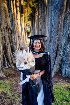 Graduation photo of Rimli between trees