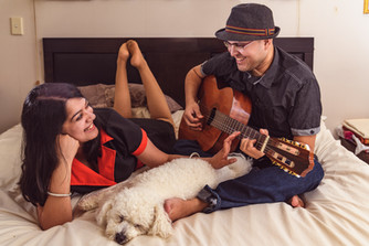 Family portrait playing guitar