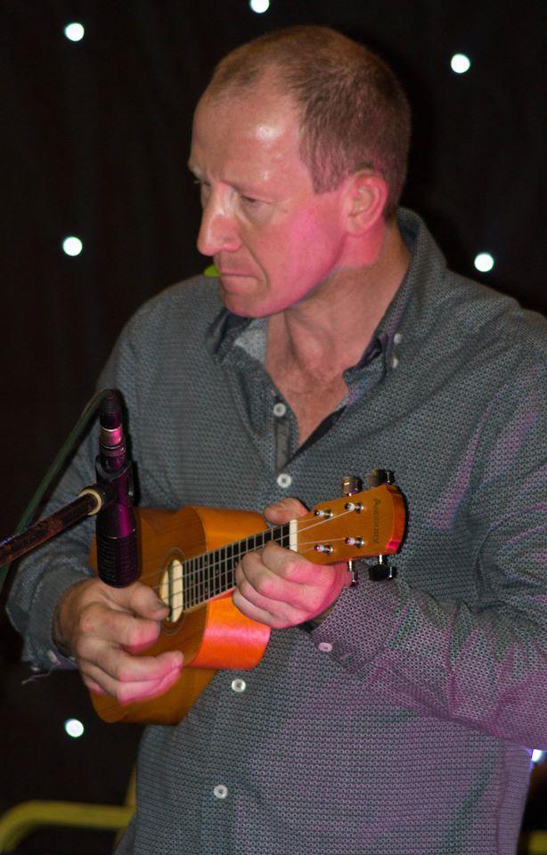 John - your guitar has shrunk!