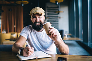 Adult bearded male in casual clothes dri