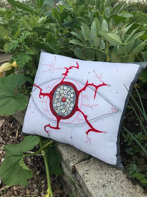 CHRISTIAN OVESEN, 'Teary Eye' embroidered cushion
