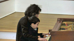 3 hand piano with a 3 year old