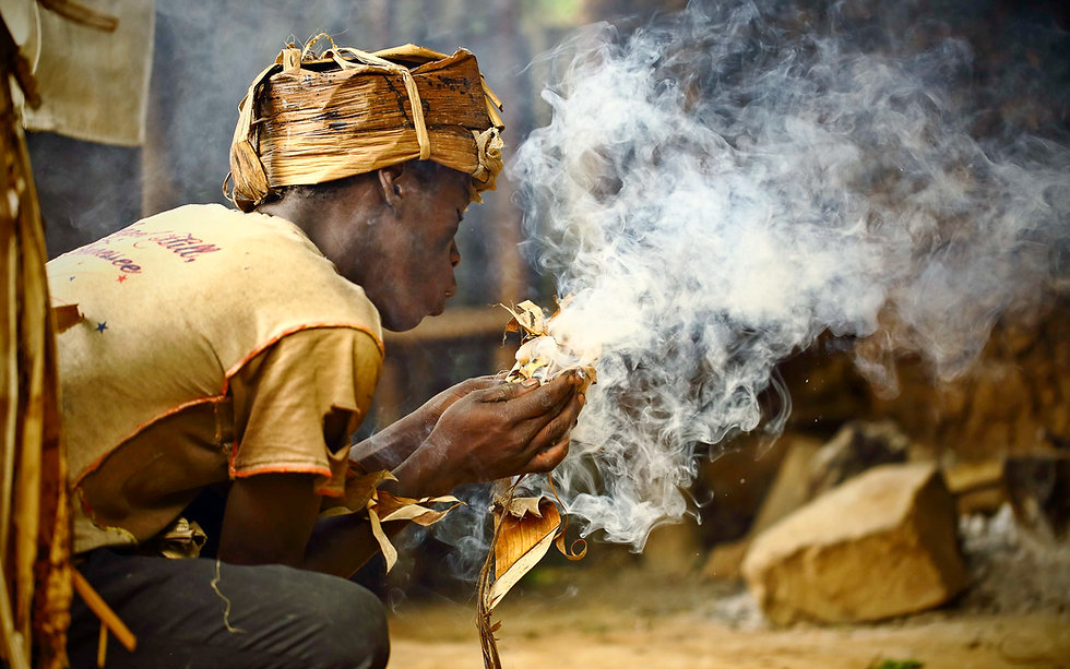 Mutwa making fire.jpg