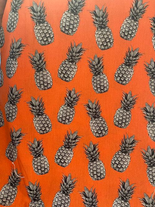 Piñas grises fondo naranja