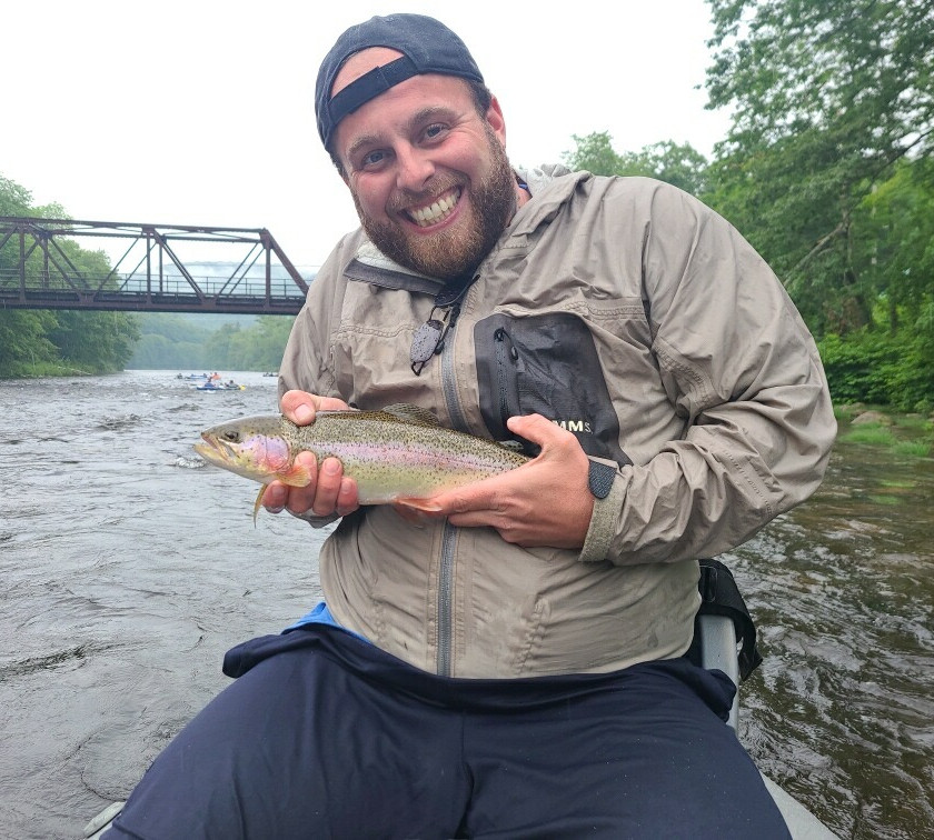 Massachusetts Veteran fishing with Rifles to Rods and holding a beautiful rainbow trout