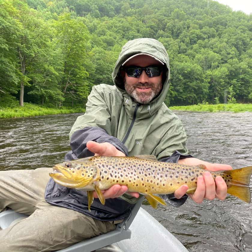 Massachusetts Veteran fishing with Rifles to Rods holding a large brown trout