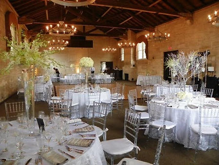 The South Hall decorated in all white and a hint of yellow in the flowers.