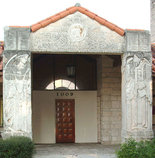 Photo of main entrance with relief sculptures on either side representing liberal arts