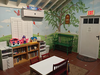 Photo of the waiting room for the Children's Dental Clinic set up for kids with low chairs
