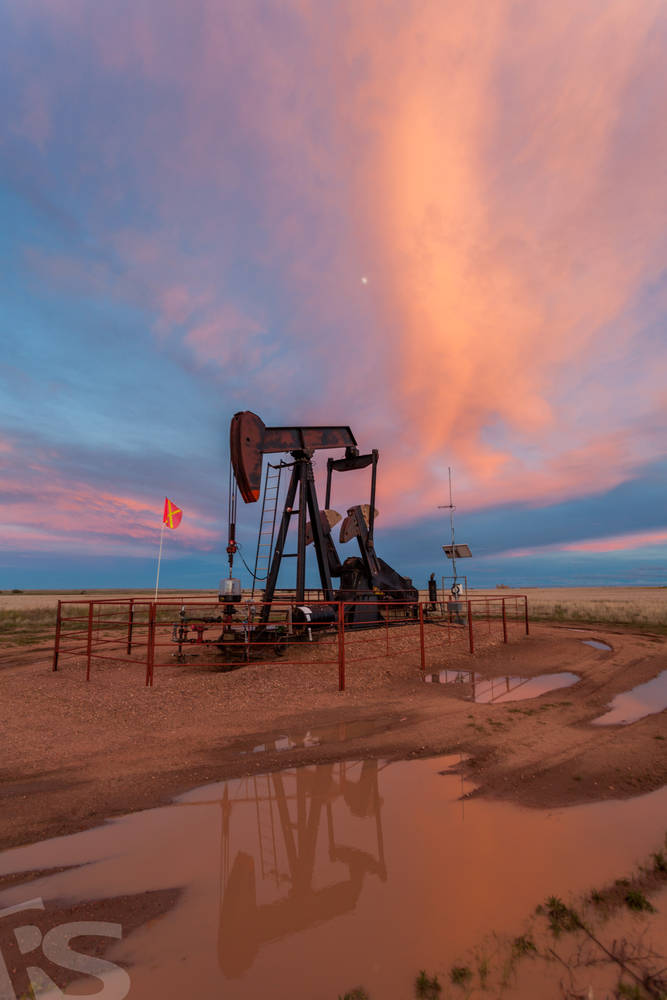 OIL FIELD AND SUNSET