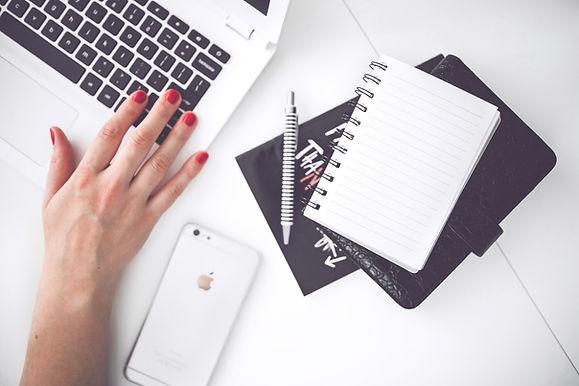 Canva - White laptop, female hand, note,
