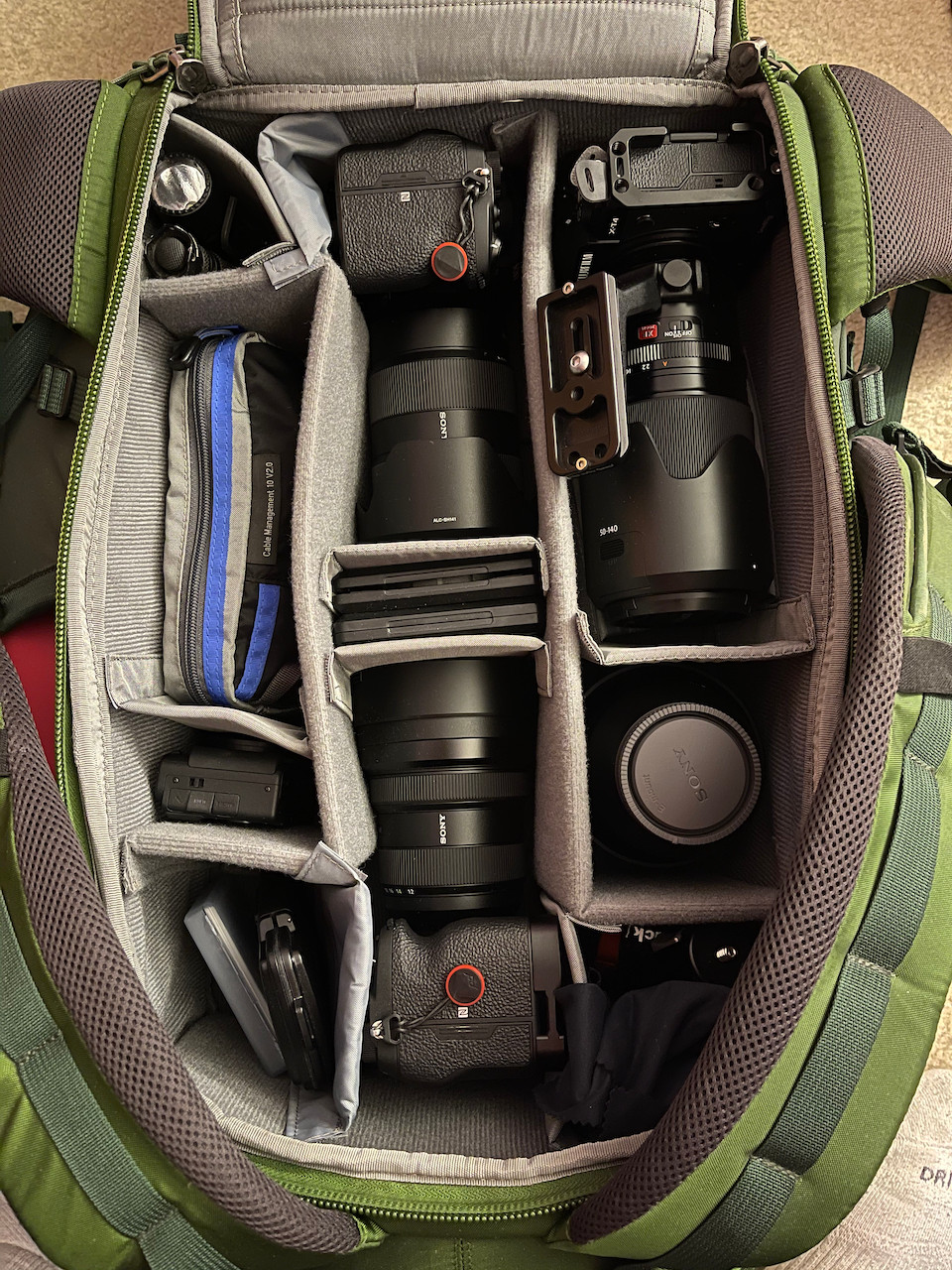 A green camera bag perfectly contains every last bit of gear needed for a professional photographer