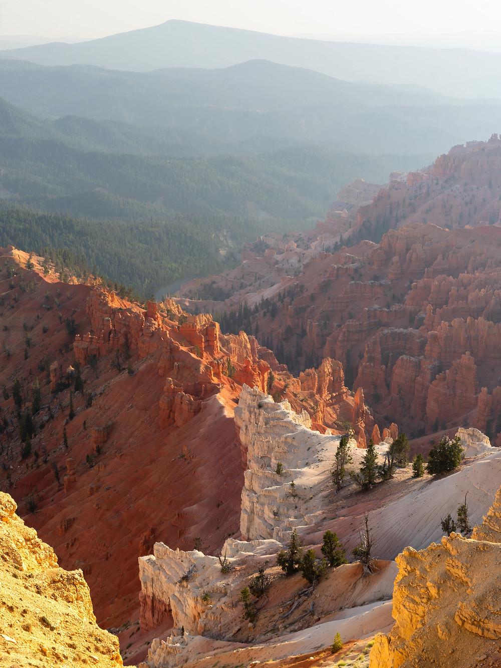 Hoodoos and bizarre red rock formations stretch as far as the eye can see in Cedar Breaks in Utah
