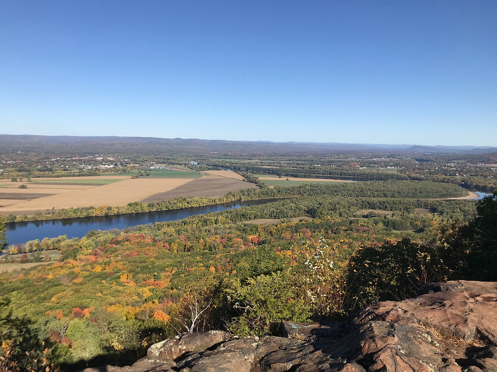 Western Massachusetts sprawls out in the beginnings of Autumn foliage as far as the eye can see from the peak of Mount Holyoke