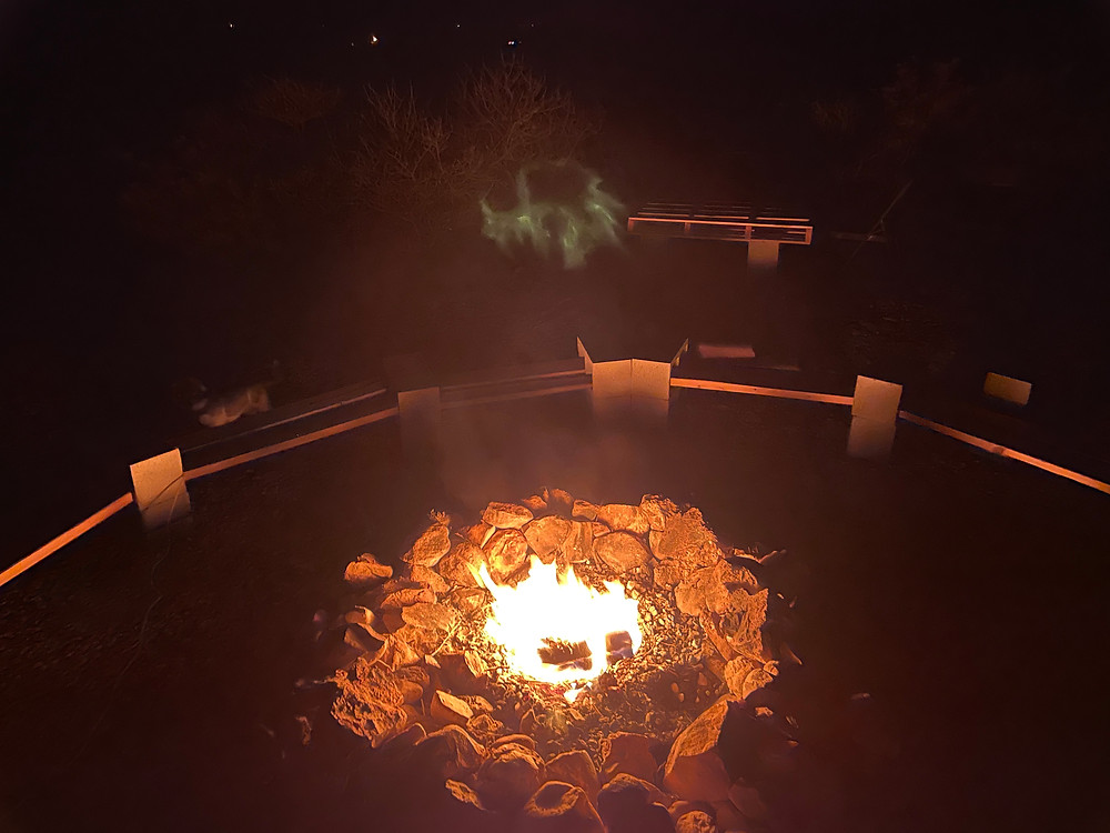 There may be a small green ghost floating above a campfire surrounded by benches deep in the Chihuahuan desert in West Texas, somewhere near the Ghost Town of Lobo