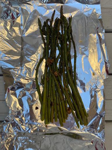 asparagus laid out on a sheet of aluminum foil