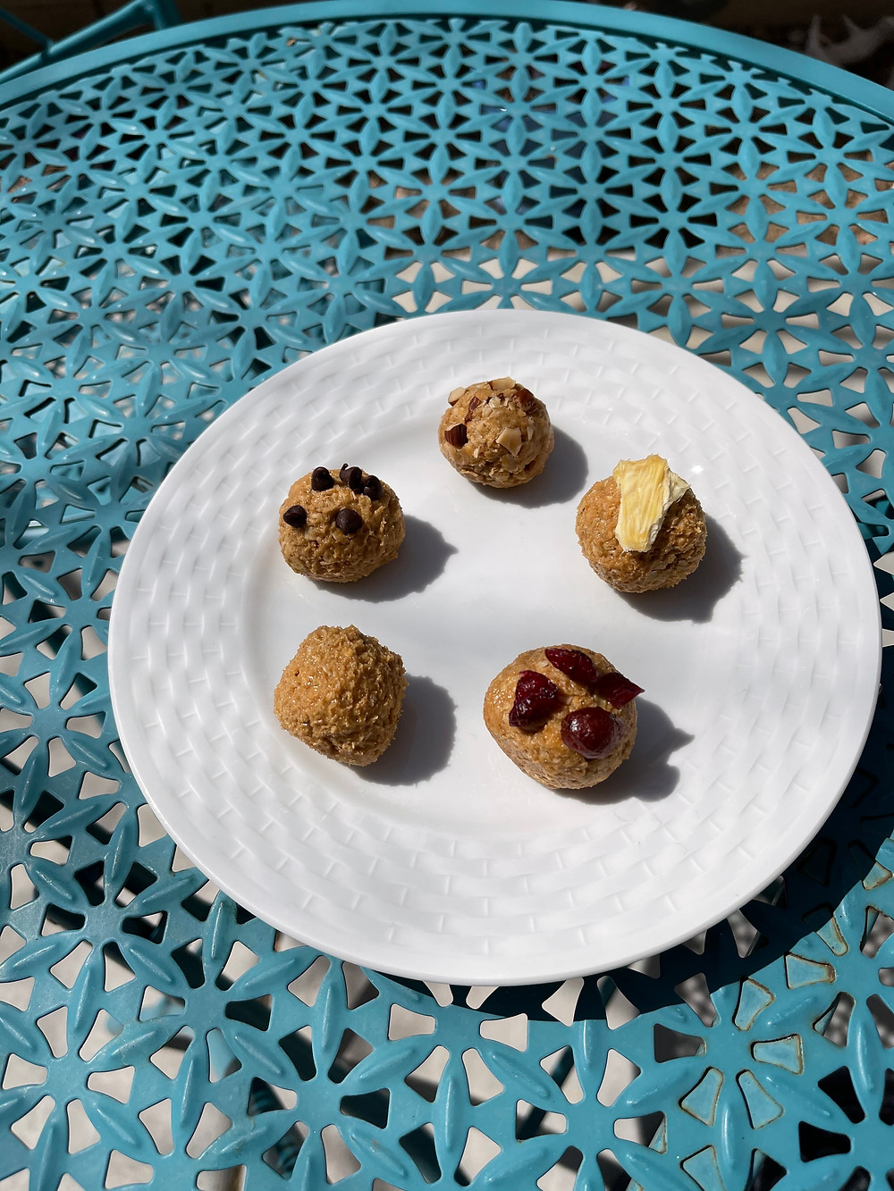 delicious, if not the most visually-appealing, energy balls to take on the trail. Peanut butter, honey, oats, and other goodies all rolled together on a plate resting on a blue table