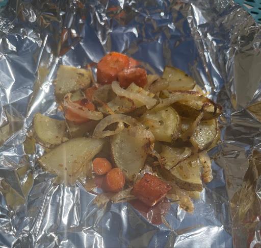 potatoes, carrots, and onions on aluminum foil